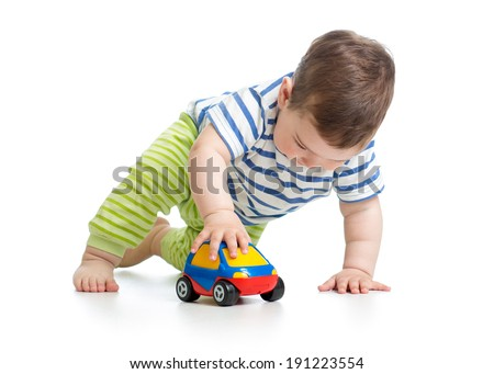 kid boy toddler playing with toy car - stock photo