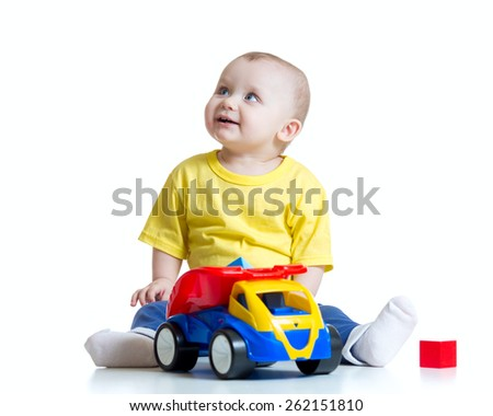 kid boy toddler playing with toy car isolated - stock photo