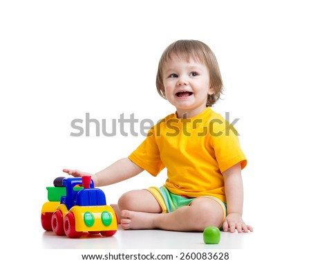 kid boy toddler playing with toy isolated - stock photo
