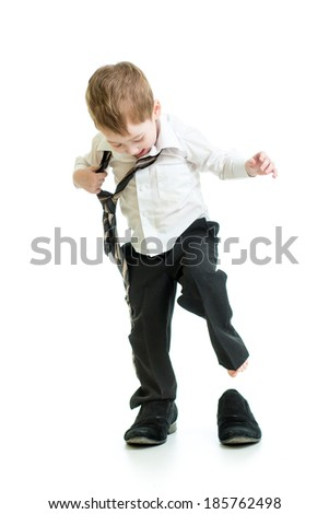 kid boy trying on father shoes - stock photo
