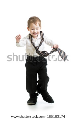 kid boy trying to go on father shoes - stock photo