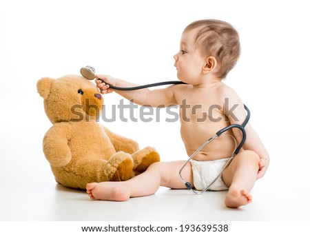 kid boy weared diaper playing doctor with toy - stock photo