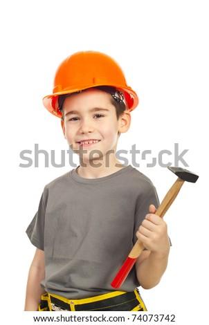 Kid boy with orange helmet holding hammer and smiling against white background - stock photo