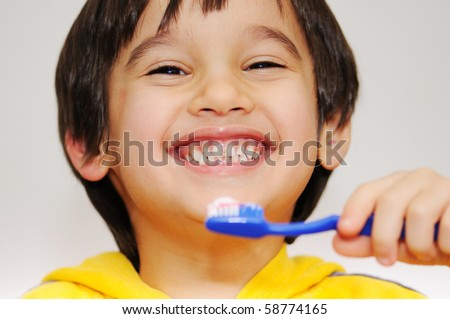 kid brushing teeth - stock photo