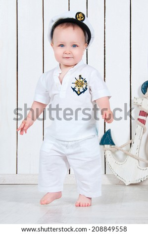 Kid captain, little baby boy dressed as a sea captain - stock photo