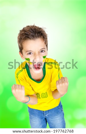 Kid celebrating a goal and wearing Brazilian soccer clothes.