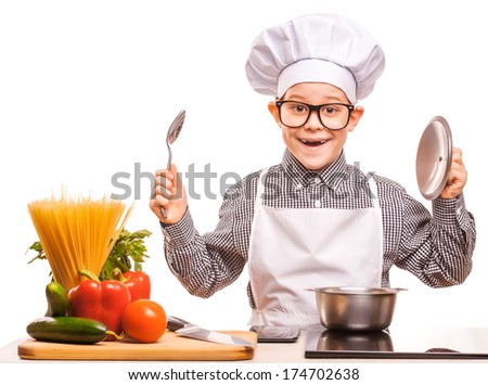kid chef is cooking in the kitchen - stock photo