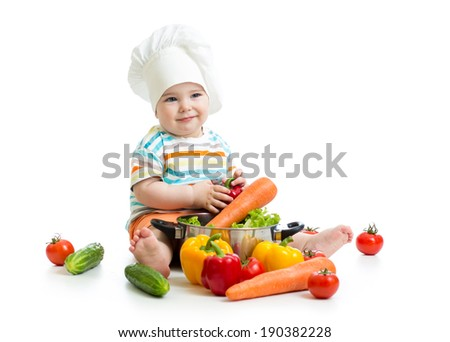 kid chef with healthy  food vegetables - stock photo