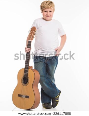 kid child boy studio portrait with guitar - stock photo