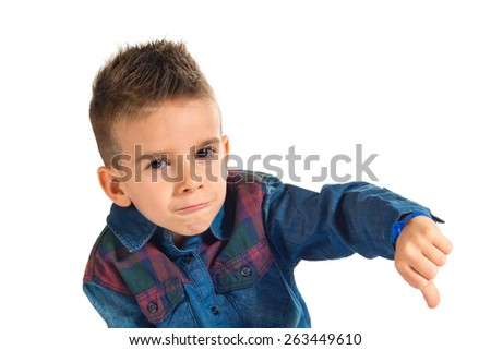 Kid doing a bad signal over white background - stock photo