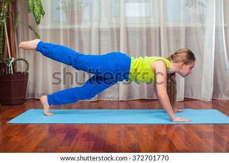 Kid doing fitness exercises - stock photo