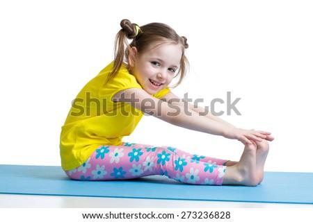 Kid doing fitness exercises isolated on white - stock photo