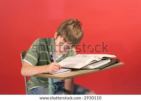 kid doing school work - stock photo