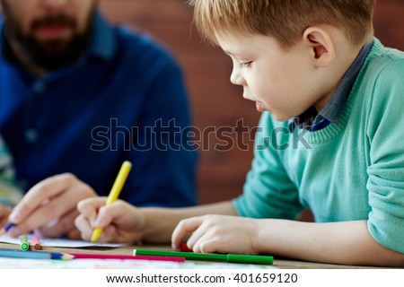 Kid drawing - stock photo