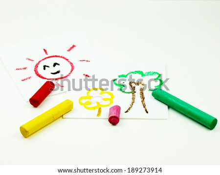 Kid drawing sun, tree and flower using colorful crayons isolated on white background - stock photo