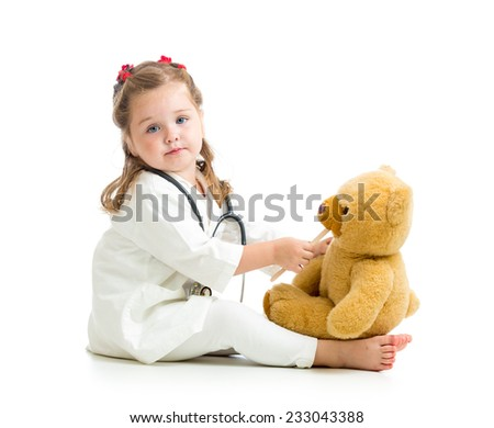 kid dressed as doctor playing with toy isolated - stock photo