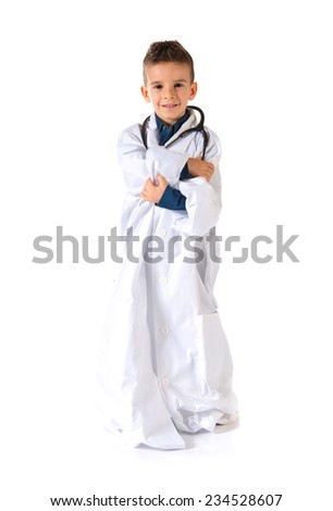 Kid dressed as doctor with his arms crossed