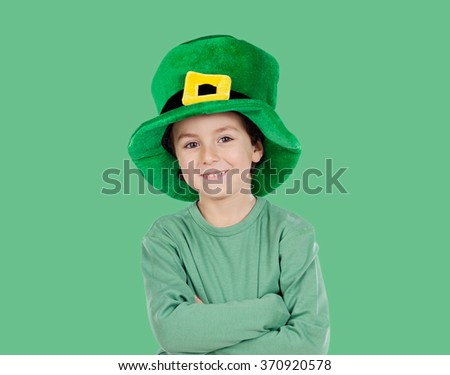Kid dressed in green with St. Patrick's hat - stock photo