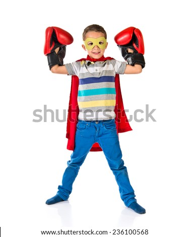 Kid dressed like superhero - stock photo