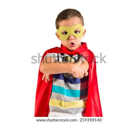 Kid dressed like superhero with his arms crossed - stock photo