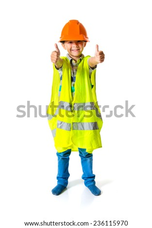 Kid dressed like worker with thumb up - stock photo