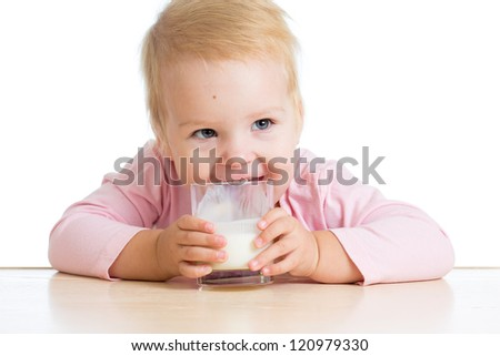 kid drinking yogurt or kefir over white - stock photo