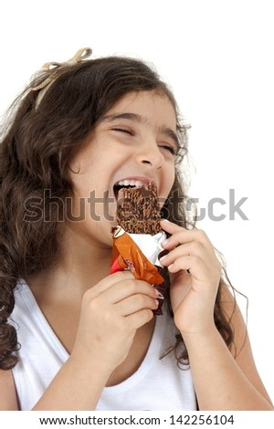 Kid eating a chocolate popsicle - stock photo