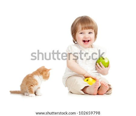 kid eating apples with cat - stock photo