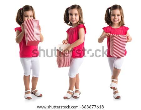 Kid eating popcorns - stock photo