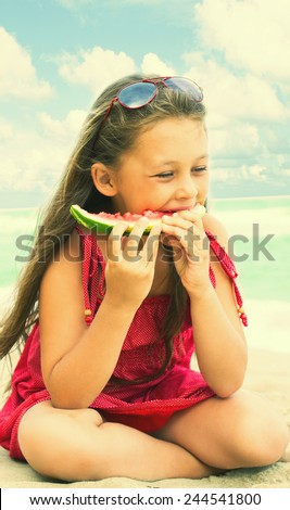 kid eating watermelon at the seaside - stock photo