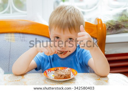 kid eats cake dessert spoon