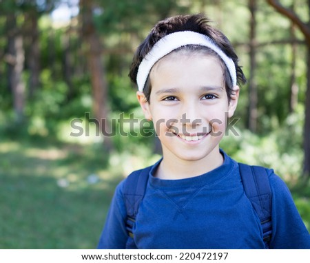 Kid enjoying in nature and posing for photography