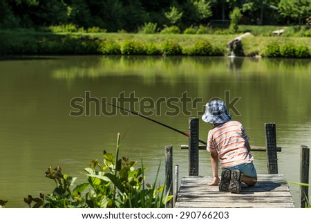 Kid fishing on the lake