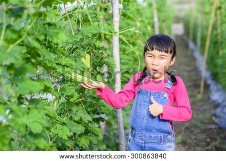 Kid gardener portrait in the green garden  - stock photo