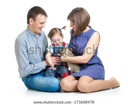 kid girl and her parents play with cat kitten