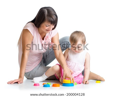 kid girl and mother play together with cup toys - stock photo