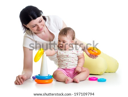 kid girl and mother playing together with toy - stock photo
