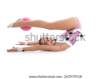 Kid girl ball rhythmic gymnastics exercise on white background - stock photo