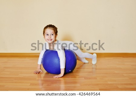 kid girl doing gymnastic exercises  on the fitball - stock photo