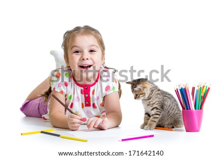kid girl drawing with pencils and playing with cat - stock photo