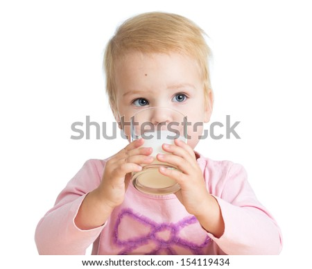 kid girl drinking yoghurt from glass isolated - stock photo