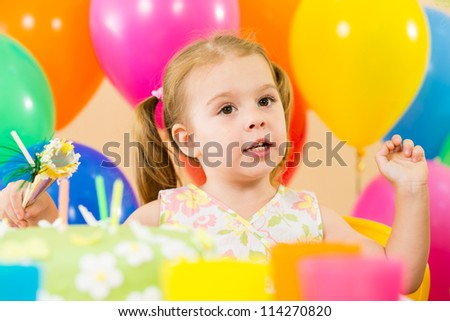 kid girl eating cake on party birthday
