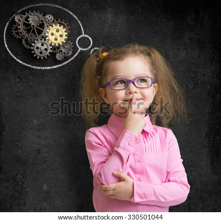 kid girl in glasses with bright idea standing near school blackboard  - stock photo