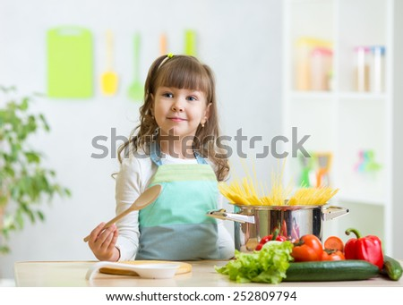 kid girl playing cook and preparing healthy food