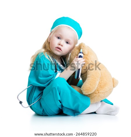 kid girl playing doctor with plush toy isolated on white - stock photo
