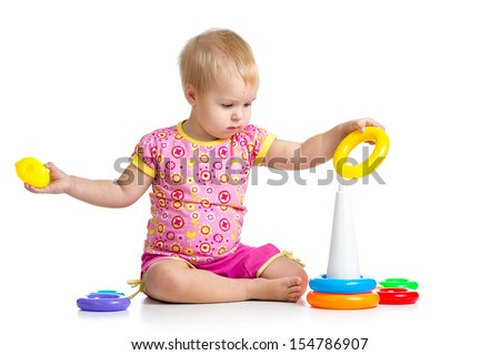 kid girl playing pyramid toy