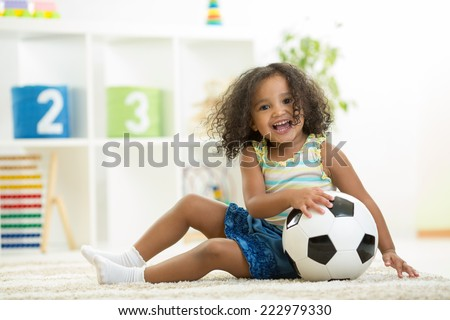 Kid girl playing toys at home or kindergarten - stock photo