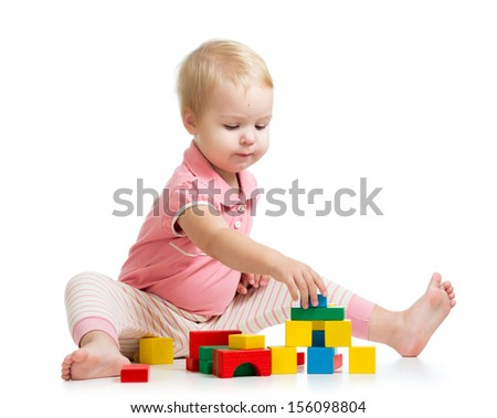 kid girl playing with wooden toys - stock photo