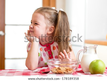 kid girl refuses to eat healthy food - stock photo