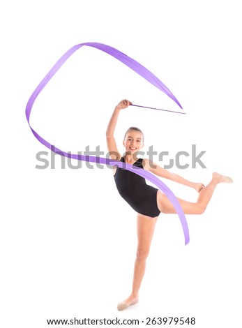 Kid girl ribbon rhythmic gymnastics exercise on white background - stock photo